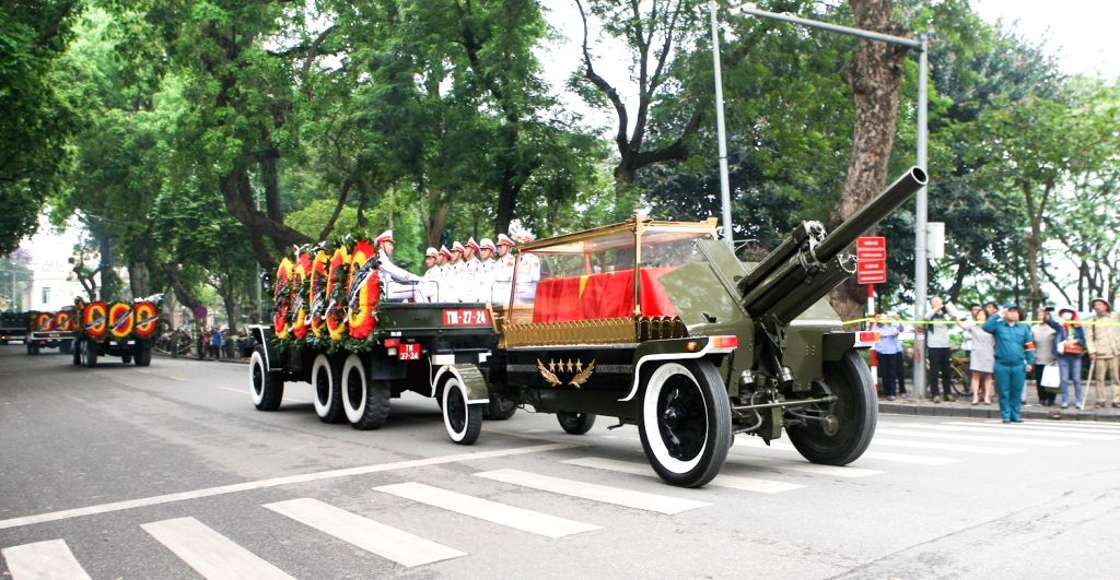 HANOI, May 3, 2019 - Motorcade carrying the coffin of Vietnamese former President Le Duc Anh drive through streets of Hanoi, capital of Vietnam, May 3, 2019. The memorial service for Vietnamese ...