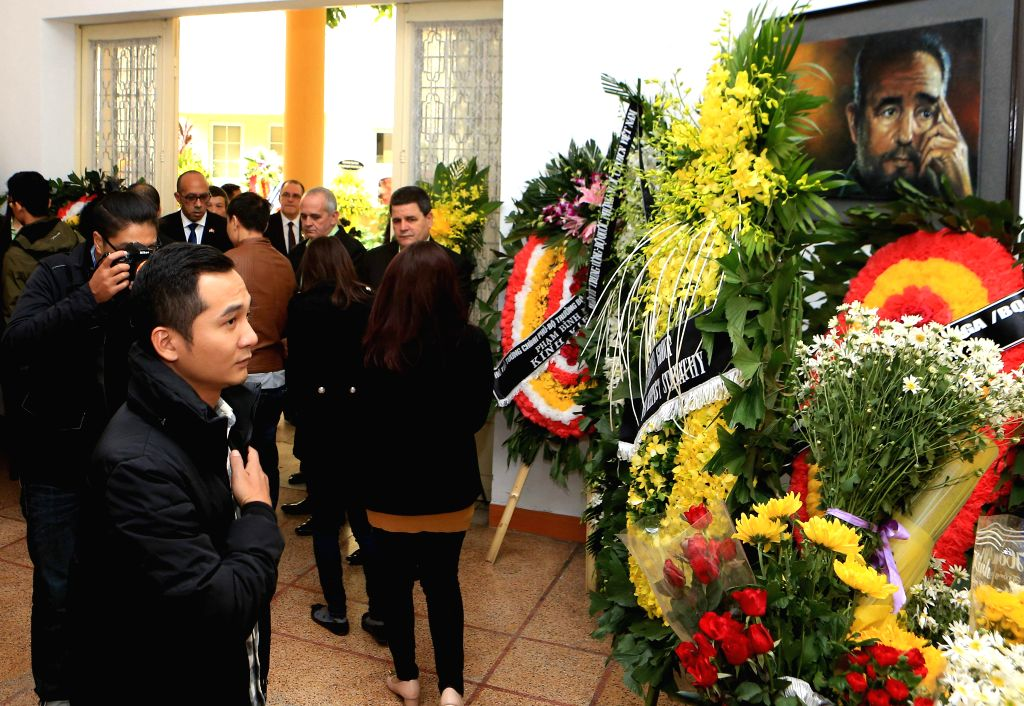 HANOI, Nov. 29, 2016 - A man pays tribute to Cuban revolutionary leader Fidel Castro at the Cuban Embassy in Hanoi, capital of Vietnam, Nov. 29, 2016. Castro died late Friday at the age of 90.
