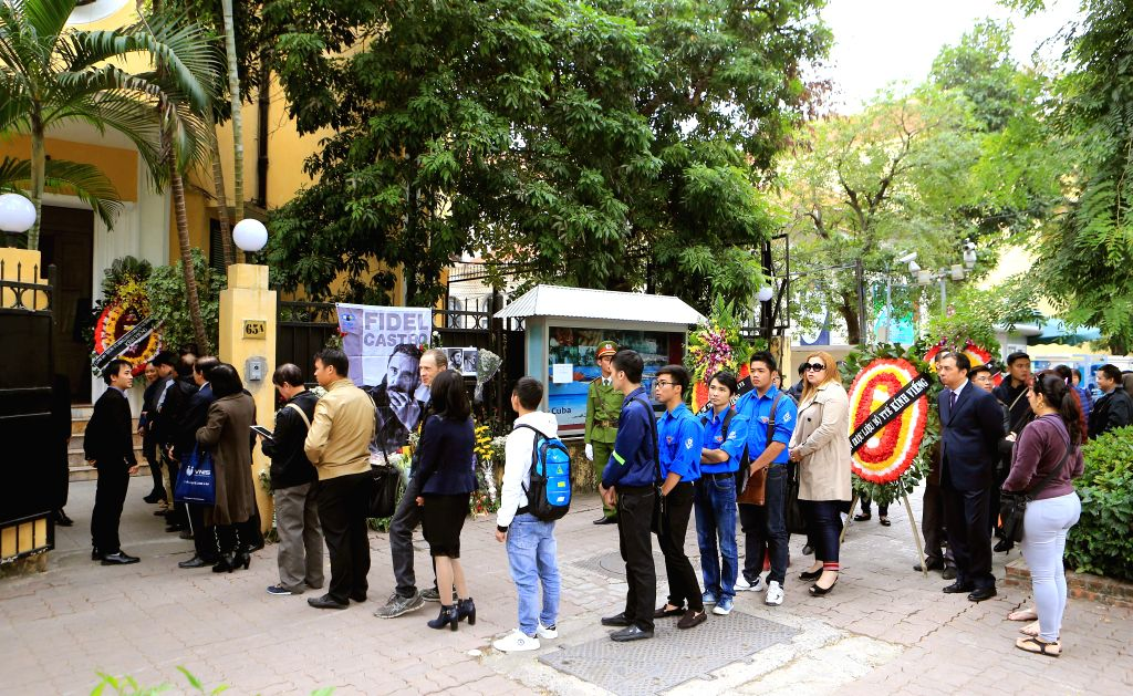 HANOI, Nov. 29, 2016 - Local people queue up and wait to pay tribute to Cuban revolutionary leader Fidel Castro at the Cuban Embassy in Hanoi, capital of Vietnam, Nov. 29, 2016. Castro died late ...
