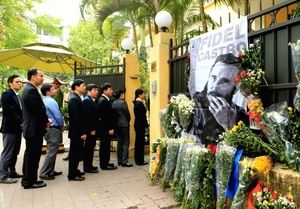 HANOI, Nov. 29, 2016 - Local people queue up and wait to pay tribute to late Cuban revolutionary leader Fidel Castro at the Cuban Embassy in Hanoi, capital of Vietnam, Nov. 29, 2016. Castro passed ...