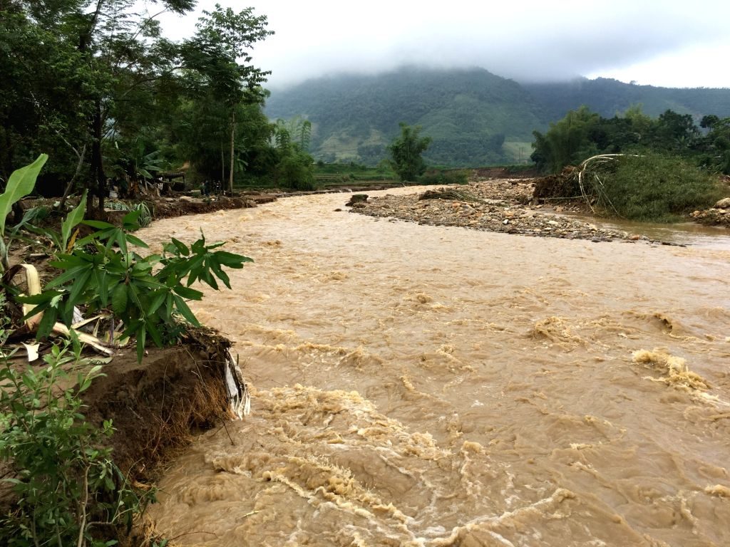 HANOI, Oct. 12, 2017 - Photo taken on Oct. 12, 2017, shows the flooding river in Yen Bai province, northern Vietnam. Landslides and floods triggered by heavy rain over the past four days in Vietnam's ...