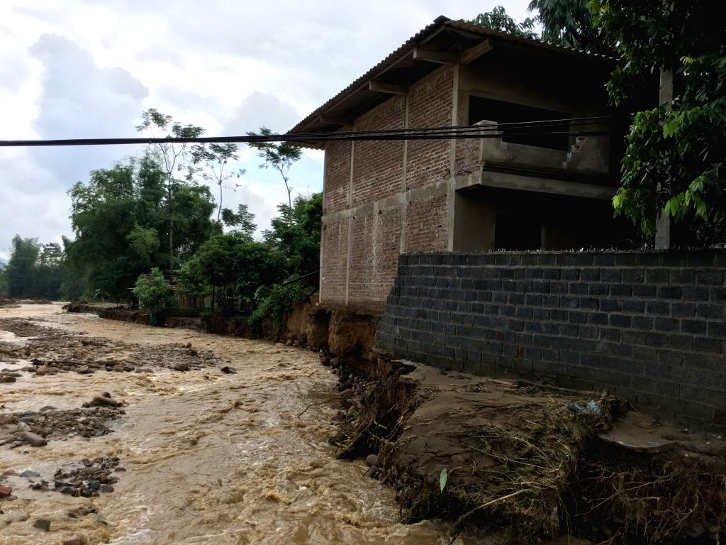 HANOI, Oct. 12, 2017 - Photo taken on Oct. 12, 2017, shows a house destroyed by floods in Yen Bai province, northern Vietnam. Landslides and floods triggered by heavy rain over the past four days in ...