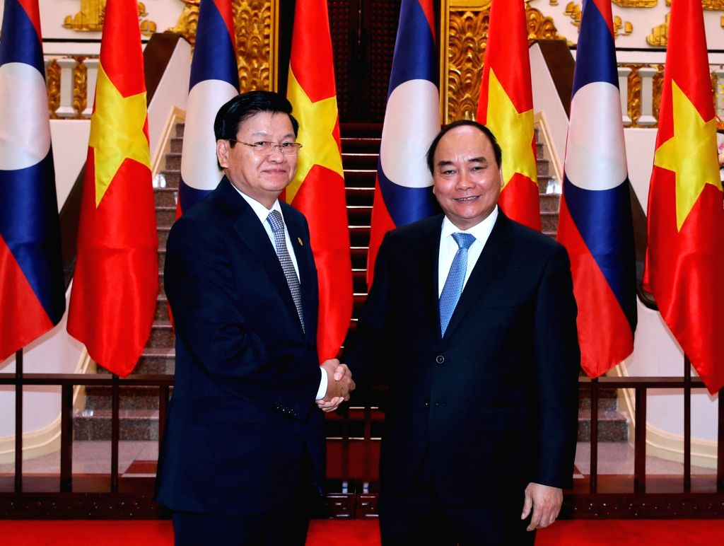 HANOI, Oct. 26, 2016 - Vietnamese Prime Minister Nguyen Xuan Phuc (R) shakes hands with Lao Prime Minister Thongloun Sisoulith in Hanoi, Vietnam, Oct. 25, 2016. Thongloun is in Hanoi to attend the ... - Nguyen Xuan Phuc