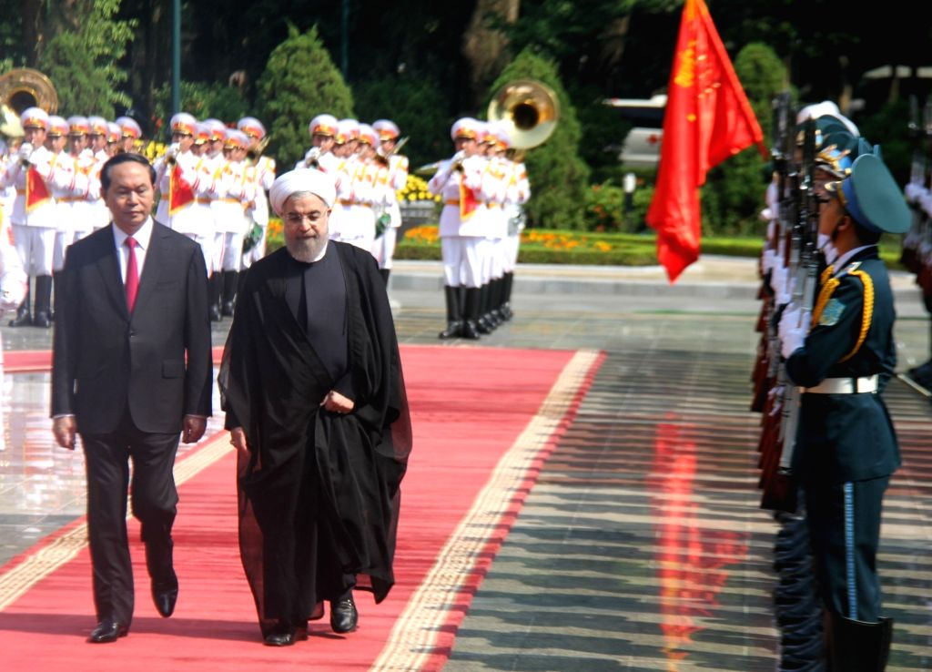 HANOI, Oct. 6, 2016 - Vietnamese President Tran Dai Quang (L) and Iranian President Hassan Rouhani review guards of honor in Hanoi, Vietnam, Oct. 6, 2016. Rohani is on an official visit to Vietnam ... - Hassan Rouhani