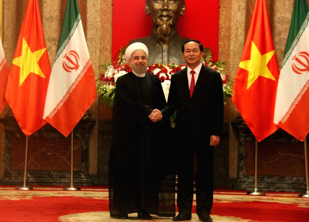 HANOI, Oct. 6, 2016 - Vietnamese President Tran Dai Quang (R) holds hands with Iranian President Hassan Rouhani in Hanoi, Vietnam, Oct. 6, 2016. Rohani is on an official visit to Vietnam from Oct. 5 ... - Hassan Rouhani