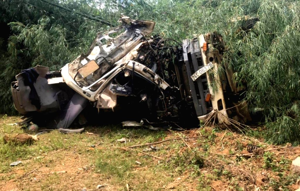 HANOI, Sept. 15, 2018 - Photo taken on Sept. 15, 2018 shows the site of a traffic accident in Vietnam's Lai Chau province. A truck crashed into an inter-provincial coach in Vietnam's northern ...
