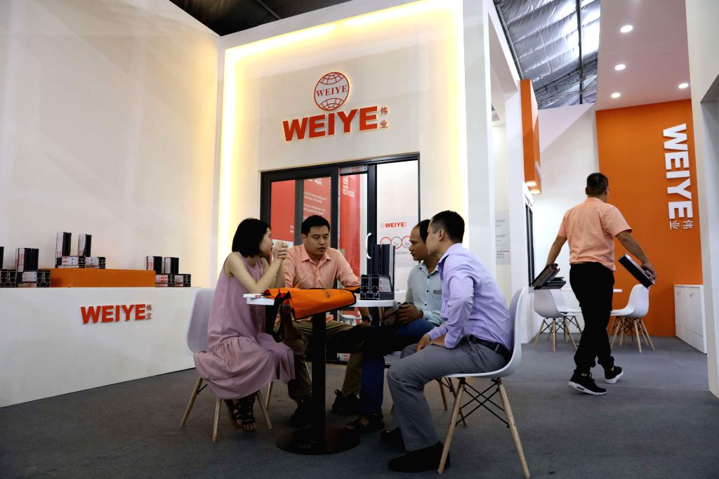 HANOI, Sept. 4, 2019 - People talk during the 2019 China Building Brand Show (Vietnam) in Hanoi, Vietnam, on Sept. 4, 2019. The 2019 China Building Brand Show (Vietnam), hosted by the Chinese ...