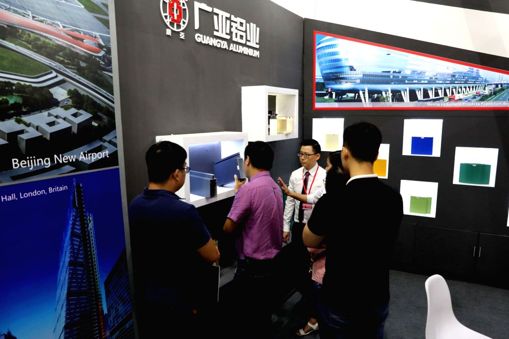 HANOI, Sept. 4, 2019 - Visitors listen to a presentation during the 2019 China Building Brand Show (Vietnam) in Hanoi, Vietnam, on Sept. 4, 2019. The 2019 China Building Brand Show (Vietnam), hosted ...