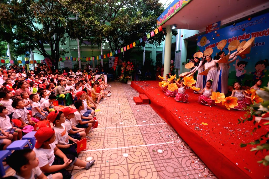 HANOI, Sept. 5, 2019 - Children attend a ceremony opening the new school year in Hanoi, Vietnam, on Sept. 5, 2019. More than 24 million students across Vietnam began the 2019-2020 school year on ...