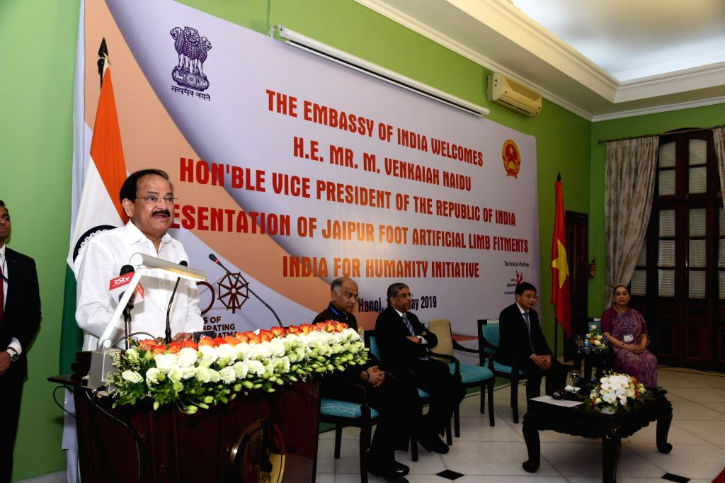 Hanoi: Vice President M. Venkaiah Naidu addresses at the presentation ceremony of Jaipur Foot Artificial Limb Fitments under the 'India for Humanity' programme to commemorate 150 years of Mahatma Gandhi at Ho Chi Minh Hall, Embassy of India in Hanoi, - M. Venkaiah Naidu