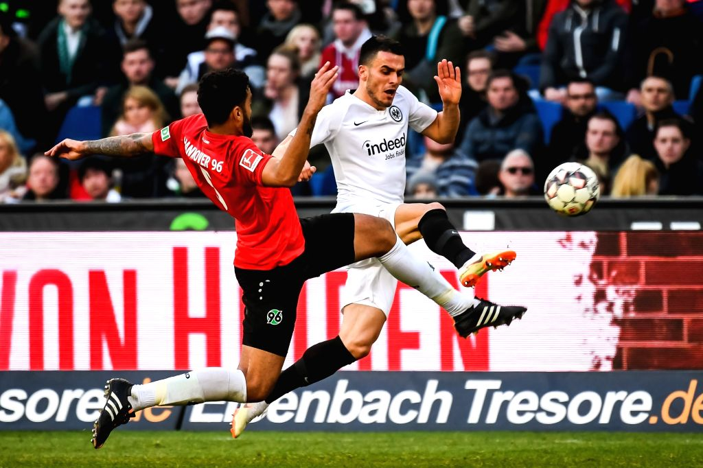 HANOVER, Feb. 25, 2019 - Frankfurt's Filip Kostic (R) vies with Hanover 96's Felipe during a German Bundesliga match between Hanover 96 and Eintracht Frankfurt, in Hanover, Germany, on Feb. 24, 2019. ...