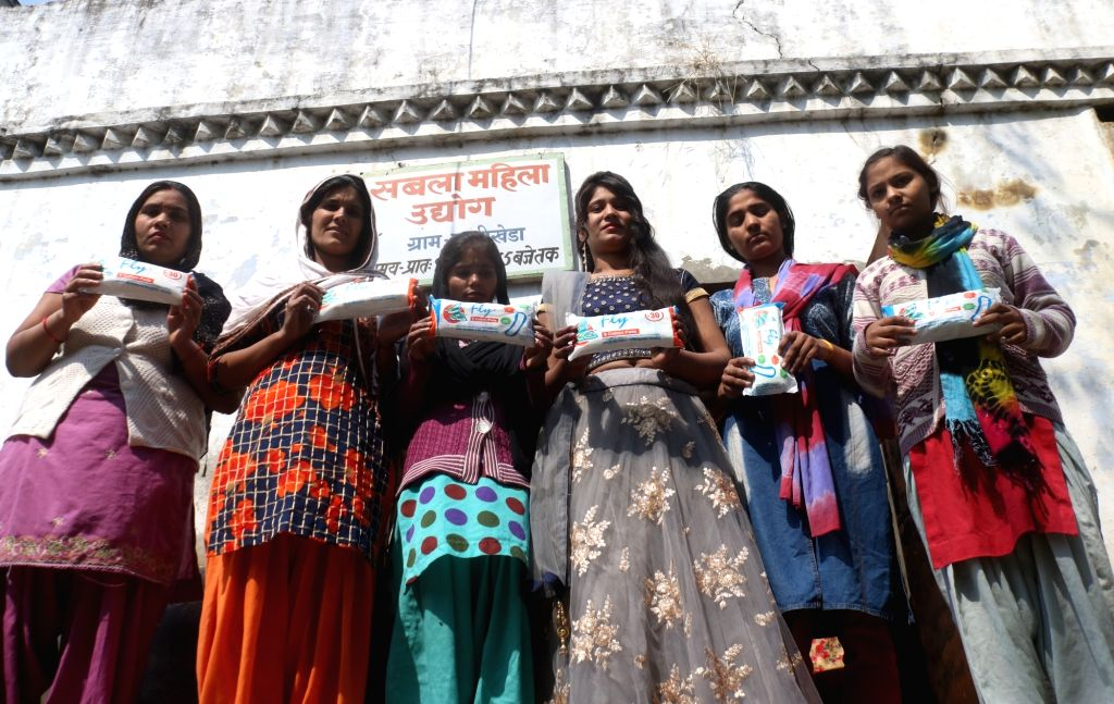 Hapur: Women show the sanitary pads manufactured at the pad-manufacturing factory in Kathikhera, Hapur, Uttar Pradesh. (Photo: Bidesh Manna/IANS)