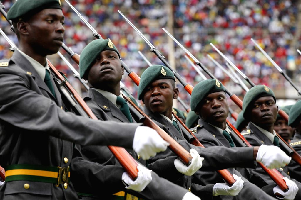 Guards of honor walk in procession at a grand ceremony held at the National Sports Stadium, in the west suburbs of Harare, Zimbabwe, April 18, 2014. Zimbabwe ...