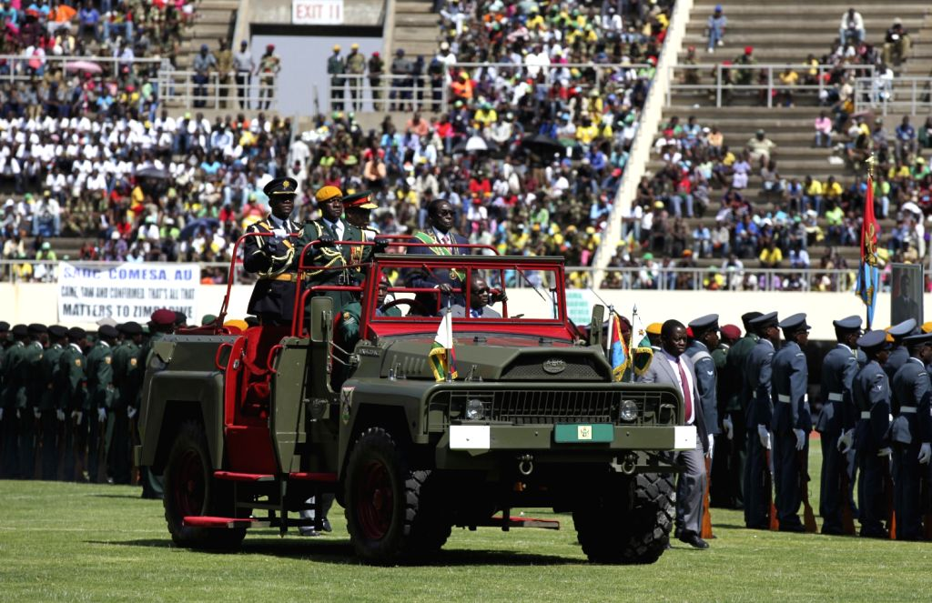 Zimbabwe's President Robert Mugabe inspects defence forces in the National Sports Stadium in Harare, Aug. 13, 2013. Zimbabwe celebrated Defence Forces Day .