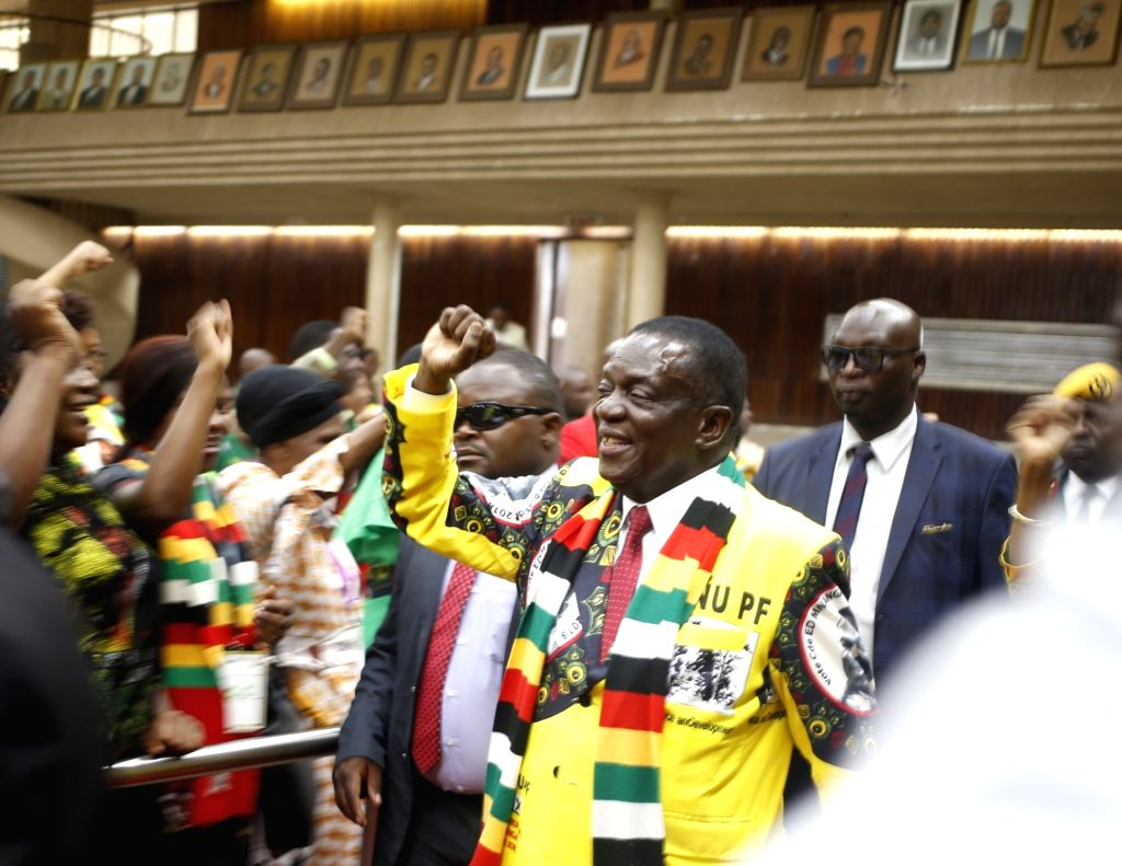 HARARE, Dec. 13, 2018 - Zimbabwean President Emmerson Mnangagwa attends a central committee meeting of ruling party ZANU-PF in Harare, Zimbabwe, Dec. 12, 2018. Zimbabwean President Emmerson Mnangagwa ...