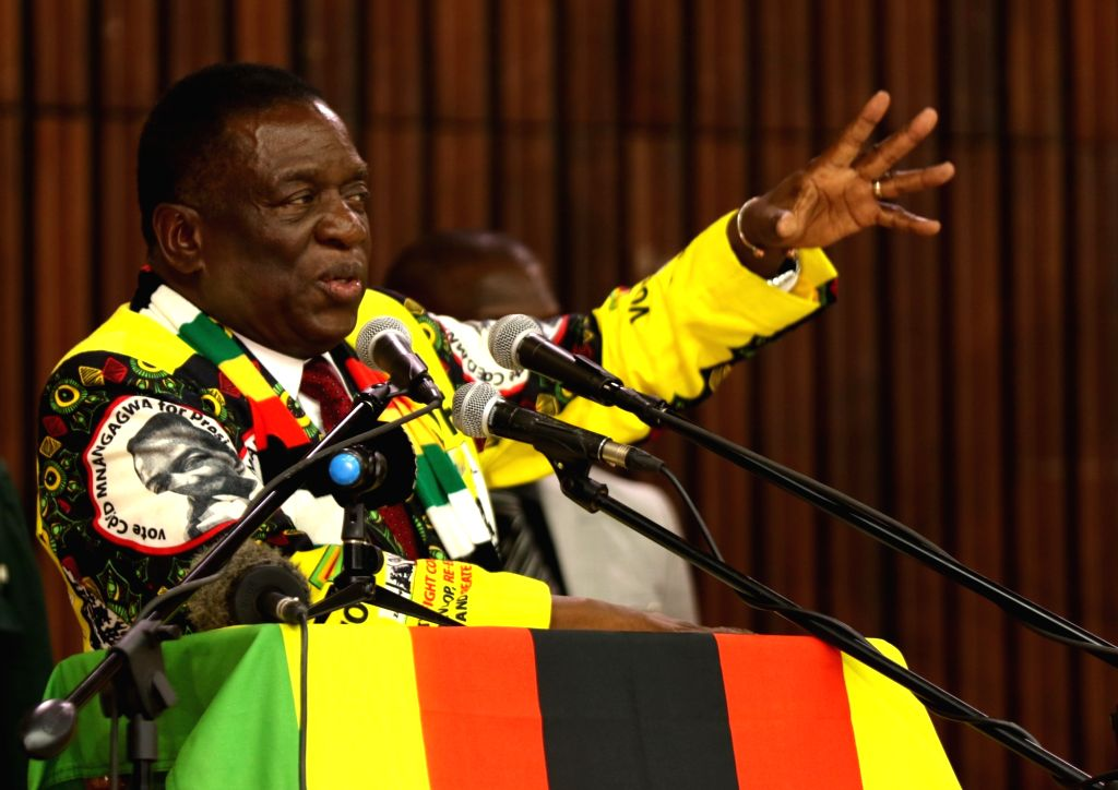 HARARE, Dec. 13, 2018 - Zimbabwean President Emmerson Mnangagwa addresses a central committee meeting of ruling party ZANU-PF in Harare, Zimbabwe, Dec. 12, 2018. Zimbabwean President Emmerson ...
