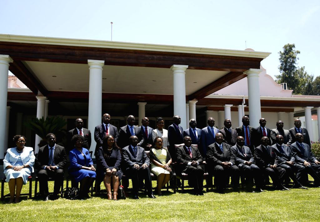 HARARE, Dec. 4, 2017 - Zimbabwean President Emmerson Mnangagwa (6th R, front) and new cabinet ministers pose for photos in State House in Harare, Zimbabwe, on Dec. 4, 2017. Zimbabwean President ...