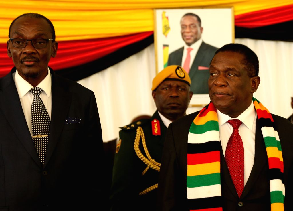 HARARE, Feb. 7, 2019 - Zimbabwean President Emmerson Mnangagwa (R) addresses to opposition party leaders during a post-election dialogue meeting at State House in Harare, Zimbabwe, Feb. 6, 2019. ...