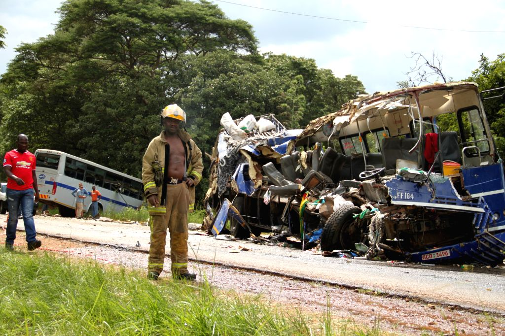 Rescue personnel work at the site of bus accident on a major highway near Harare, capital of Zimbabwean. on Jan. 18, 2015. At least 25 people were killed and 46 ...