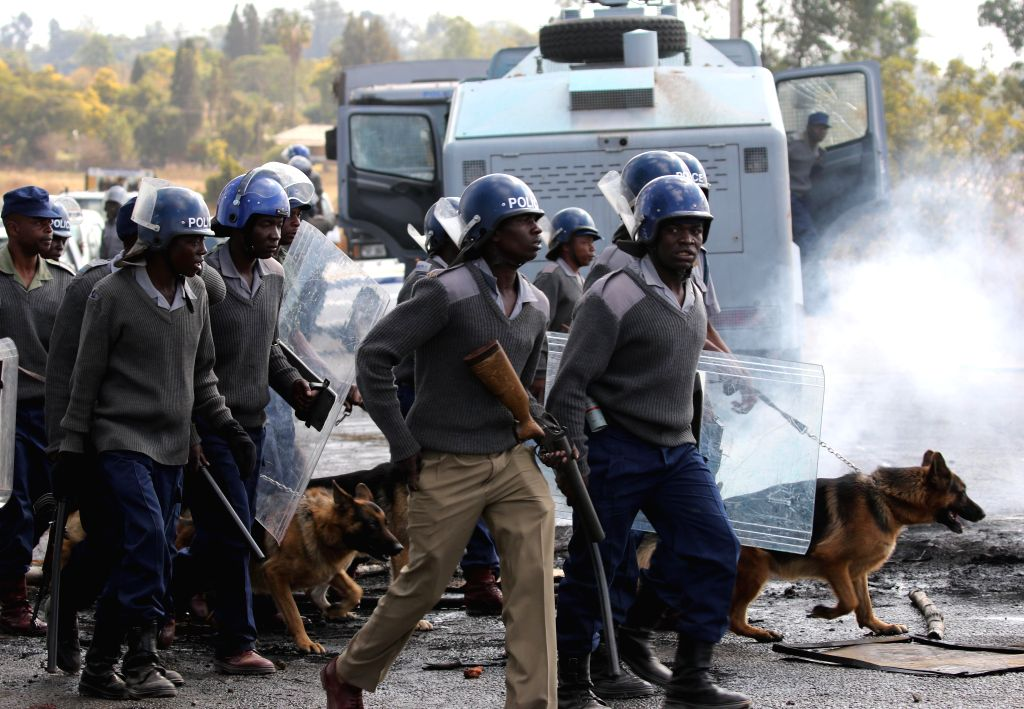 HARARE, July 4, 2016 - Police are deployed to quell disturbances during a protest in the impoverished suburb of Epworth on the outskirts of Harare, Zimbabwe, July 4, 2016. Zimbabwean police said they ...