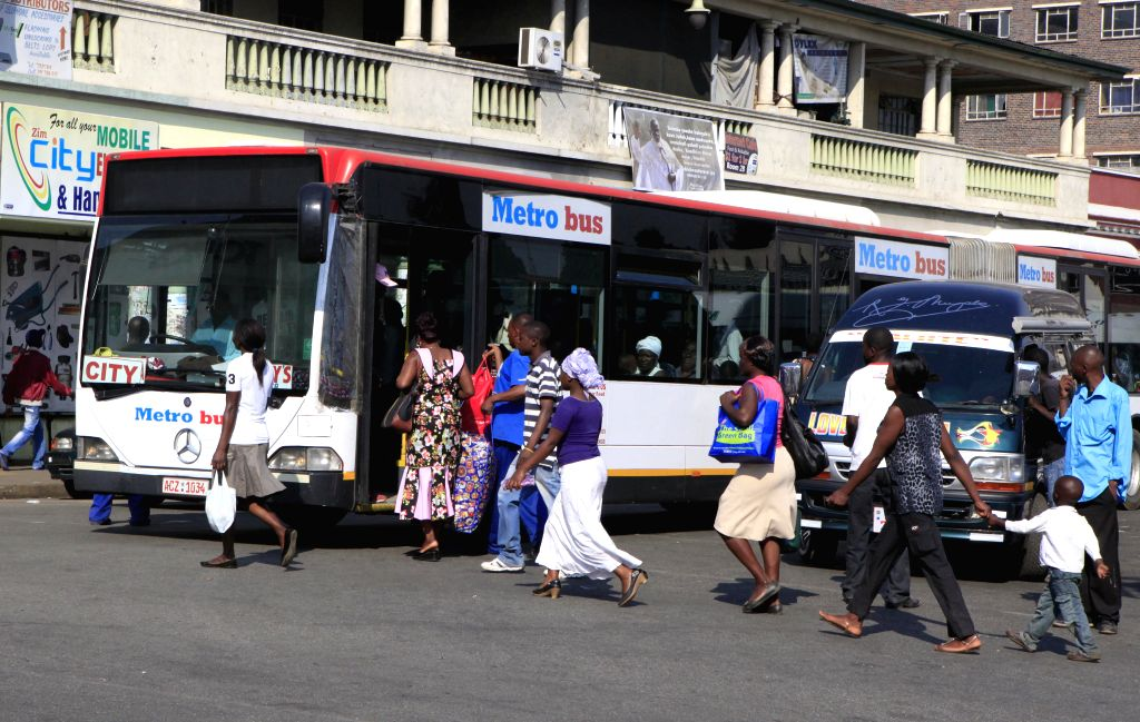 Commuters board a Mercede-Benz passenger bus in Harare, Zimbabwe, July 8, 2014. Zimbabwe's Transport Minister Obert Mpofu said last month that the government aims to . - Obert Mpofu