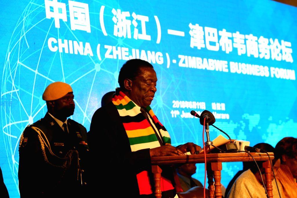 HARARE, June 11, 2018 - Zimbabwean President Emmerson Mnangagwa (Front) addresses the opening ceremony of Zimbabwe-China Business Forum in Harare, Zimbabwe, on June 11, 2018. Zimbabwe and China on ...
