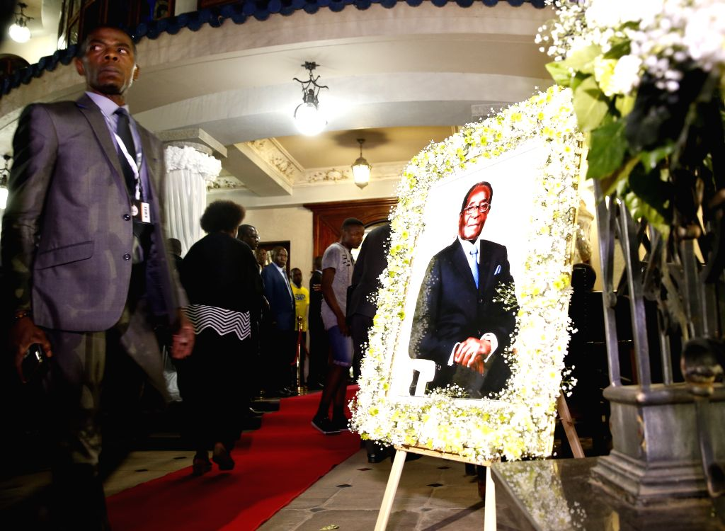 HARARE, Sept. 11, 2019 - A portrait of the late former Zimbabwean President Robert Mugabe is seen at Mugabe's residence in Harare, Zimbabwe, on Sept. 11, 2019. The body of the late former Zimbabwean ...