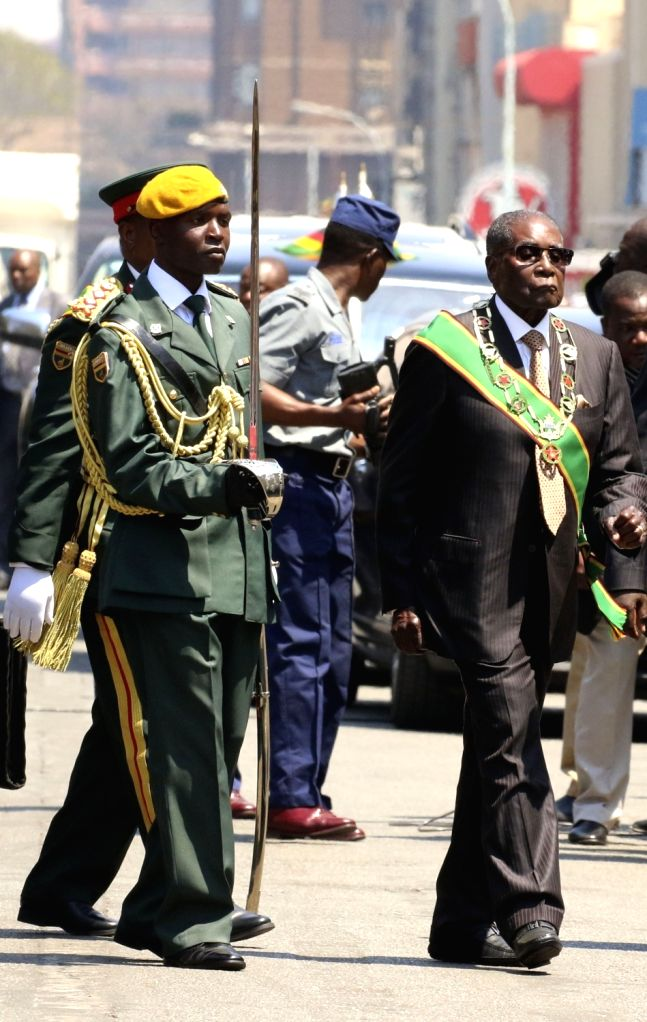 HARARE, Sept. 12, 2017 - Zimbabwean President Robert Mugabe (R, front) arrives to officially open the new session of Parliament in Harare, Zimbabwe, Sept. 12, 2017. Zimbabwean President Robert Mugabe ...