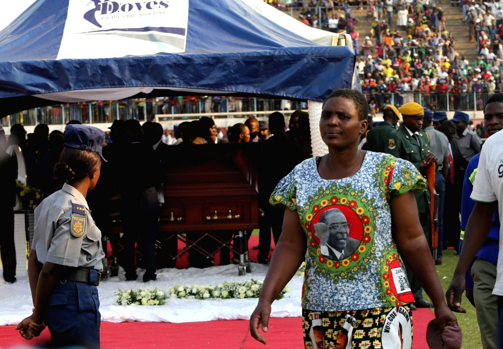 HARARE, Sept. 12, 2019 - A woman leaves after paying respect to the late former Zimbabwean President Robert Mugabe in Harare, Zimbabwe, on Sept. 12, 2019. Thousands of Zimbabweans headed to Rufaro ...