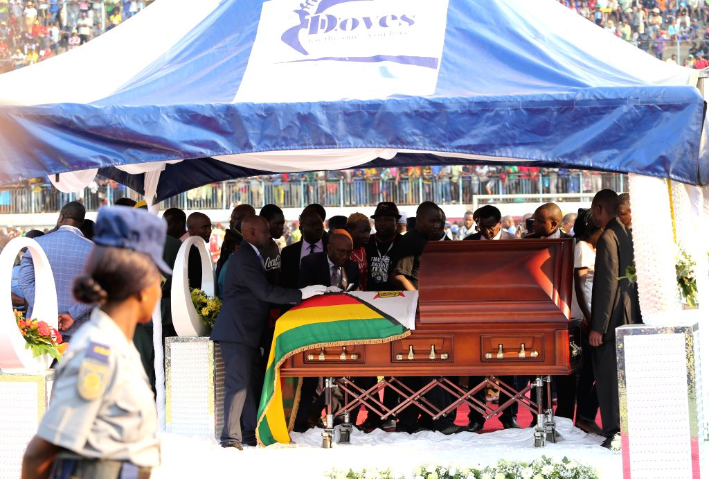HARARE, Sept. 12, 2019 - People pay respect to the late former Zimbabwean President Robert Mugabe in Harare, Zimbabwe, on Sept. 12, 2019. Thousands of Zimbabweans headed to Rufaro Sports Stadium to ...