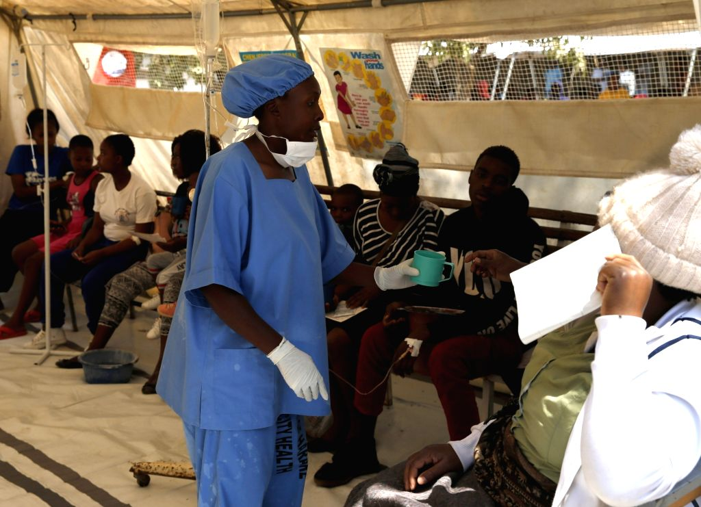 HARARE, Sept. 13, 2018 - Cholera patients receive treatment at a local hospital in Harare, Zimbabwe, Sept. 12, 2018. Zimbabwean police have banned public gatherings in the capital Harare following a ...