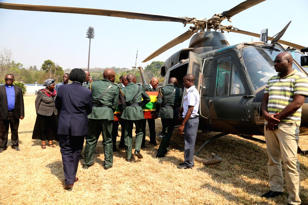 HARARE, Sept. 13, 2019 - The casket of the late former Zimbabwean President Robert Mugabe is taken to a helicopter which will depart from his residence to Rufaro Stadium in Harare, Zimbabwe, on Sept. ...
