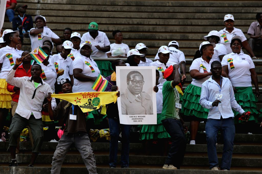 HARARE, Sept. 14, 2019 - People attend Robert Mugabe's state funeral in Harare, Zimbabwe, on Sept. 14, 2019. Dignitaries including former and current African leaders on Saturday paid tribute to the ...