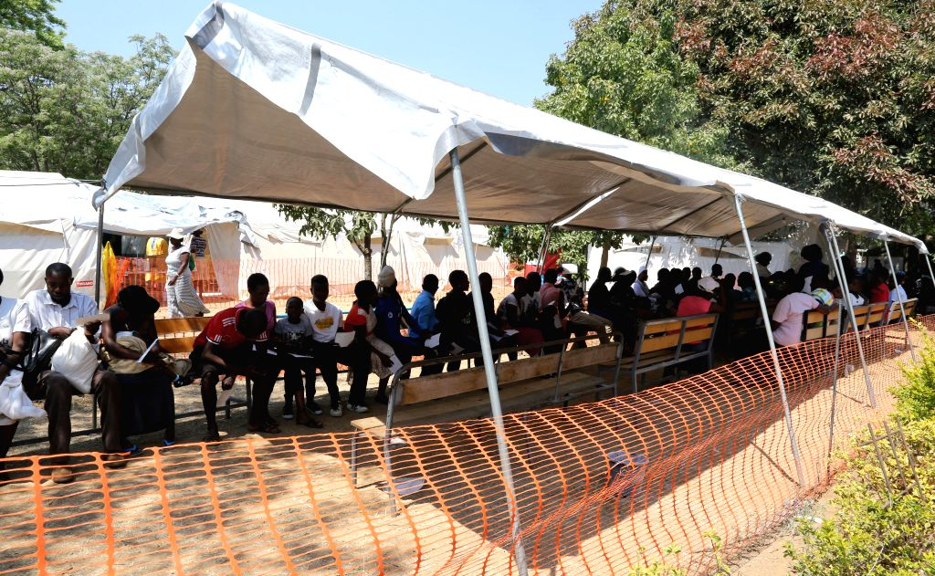 HARARE, Sept. 15, 2018 - Suspected cholera patients wait to be verified and treated in a polyclinic in Harare, Zimbabwe, on Sept. 14, 2018. A cholera outbreak that has so far claimed at least 25 ...