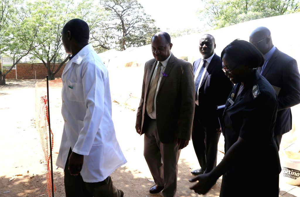 HARARE, Sept. 15, 2018 - Zimbabwean Health Minister Obadiah Moyo (2nd L) visits cholera patients in a polyclinic in Harare, Zimbabwe, on Sept. 14, 2018. A cholera outbreak that has so far claimed at ... - Obadiah Moyo