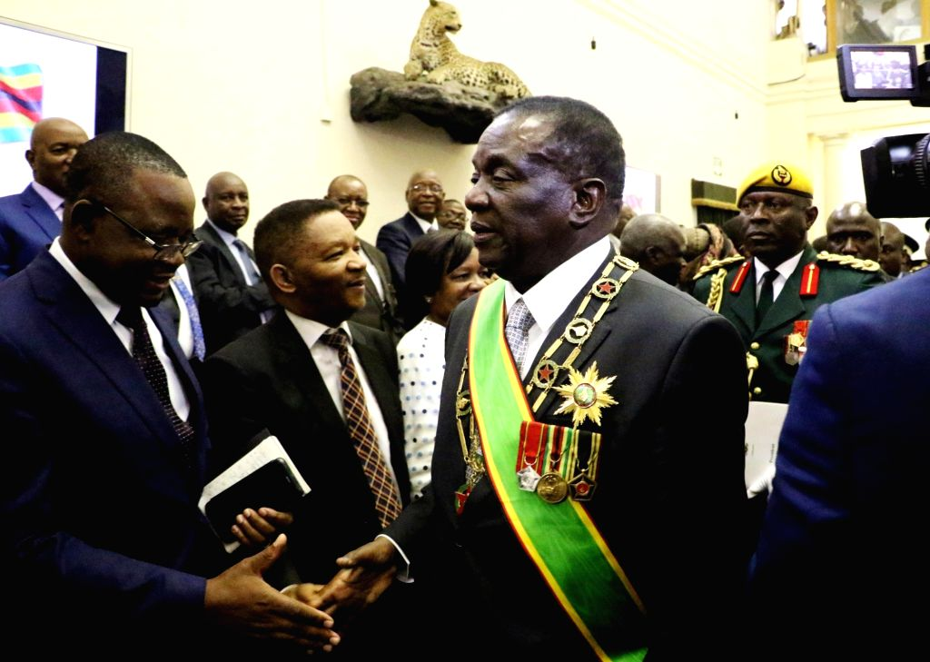 HARARE, Sept. 18, 2018 - Zimbabwean President Emmerson Mnangagwa (C) shakes hands with a parliament member before delivering his first state of the nation address to open the first session of the ...