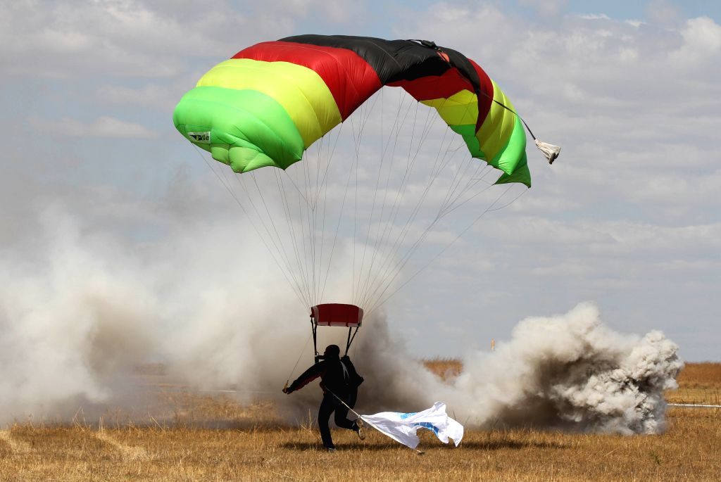 A parachuter lands during the Big African Show held at Prince Charles Airport on the outskirts of Harare, Zimbabwe, Sept. 7, 2014. Thousands of people paid to watch .