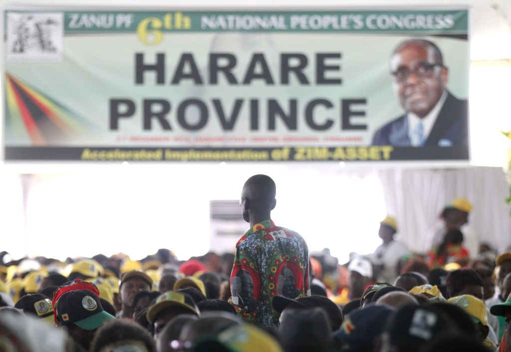 Harare (Zimbabwe): Members of Zimbabwean President Robert Mugabe's party listen to his speech as he officially opens the ruling Zanu PF party's elective congress in Harare, Zimbabwe, Dec. 4, 2014. ...