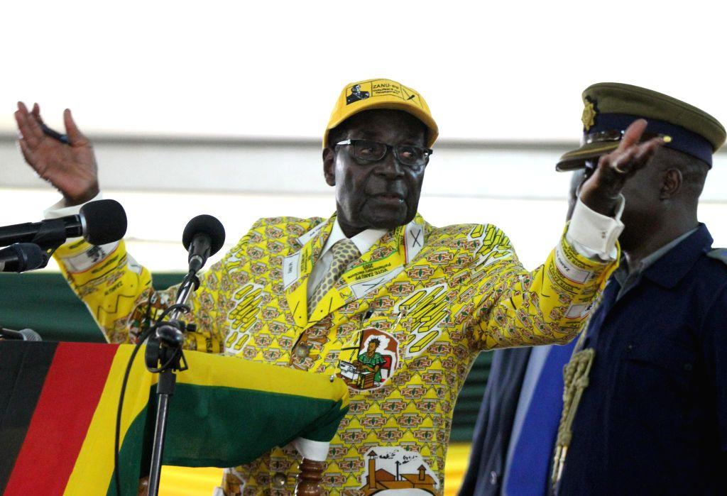 Harare (Zimbabwe): Zimbabwean President Robert Mugabe addresses the gathering as he officially opens the ruling Zanu PF party's elective congress in Harare, Zimbabwe, Dec. 4, 2014. Zimbabwean ...
