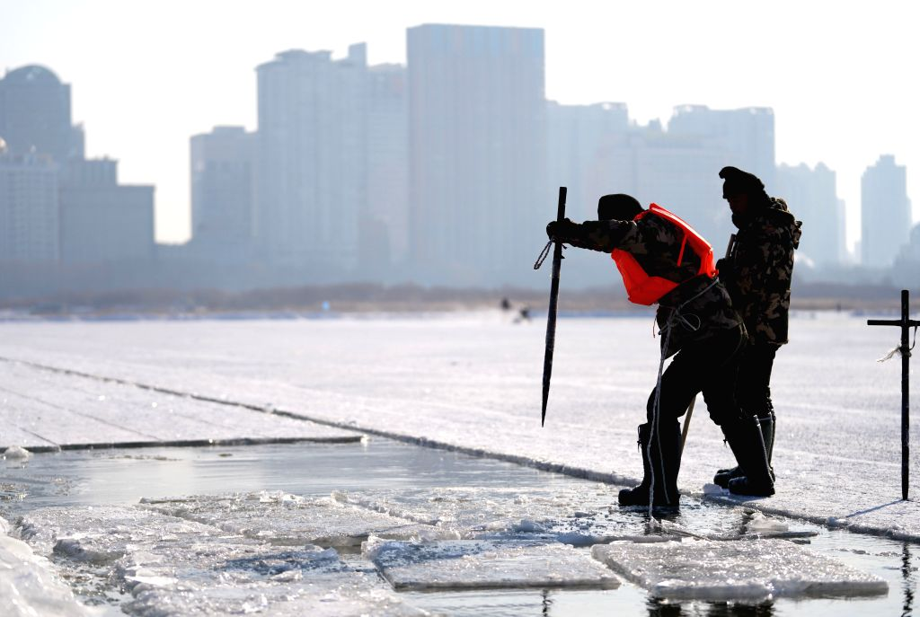 HARBIN, Dec. 7, 2019 - An ice digger drills the ice at an ice digging festival in Harbin, capital of northeast China's Heilongjiang Province, Dec. 7, 2019.