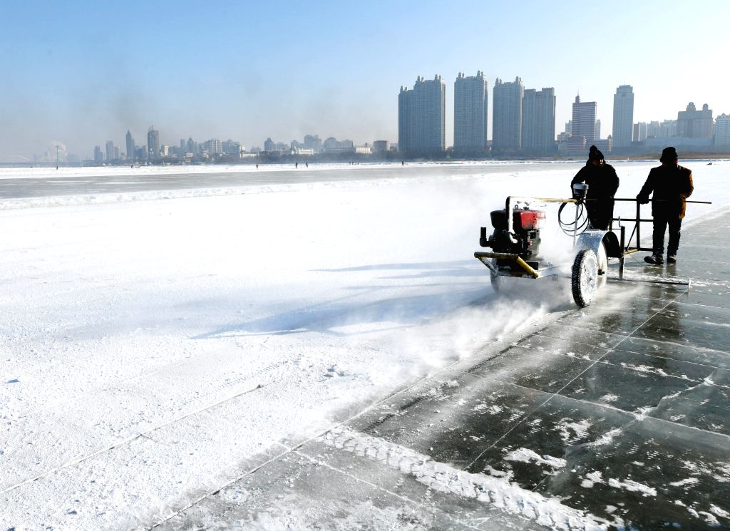 HARBIN, Dec. 7, 2019 - Ice diggers use an electric motor saw to incise ice at an ice digging festival in Harbin, capital of northeast China's Heilongjiang Province, Dec. 7, 2019.