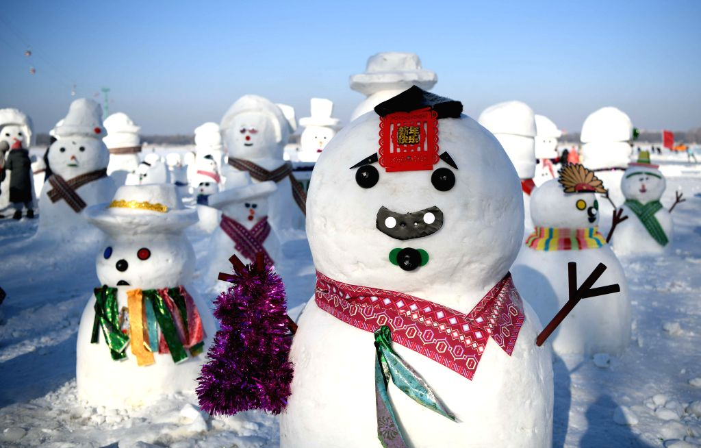 HARBIN, Feb. 3, 2019 - Photo taken on Jan. 2, 2019 shows snowmen on the riverbank of Songhua River in Harbin, capital of northeast China's Heilongjiang Province. Various adorable snowmen are ...
