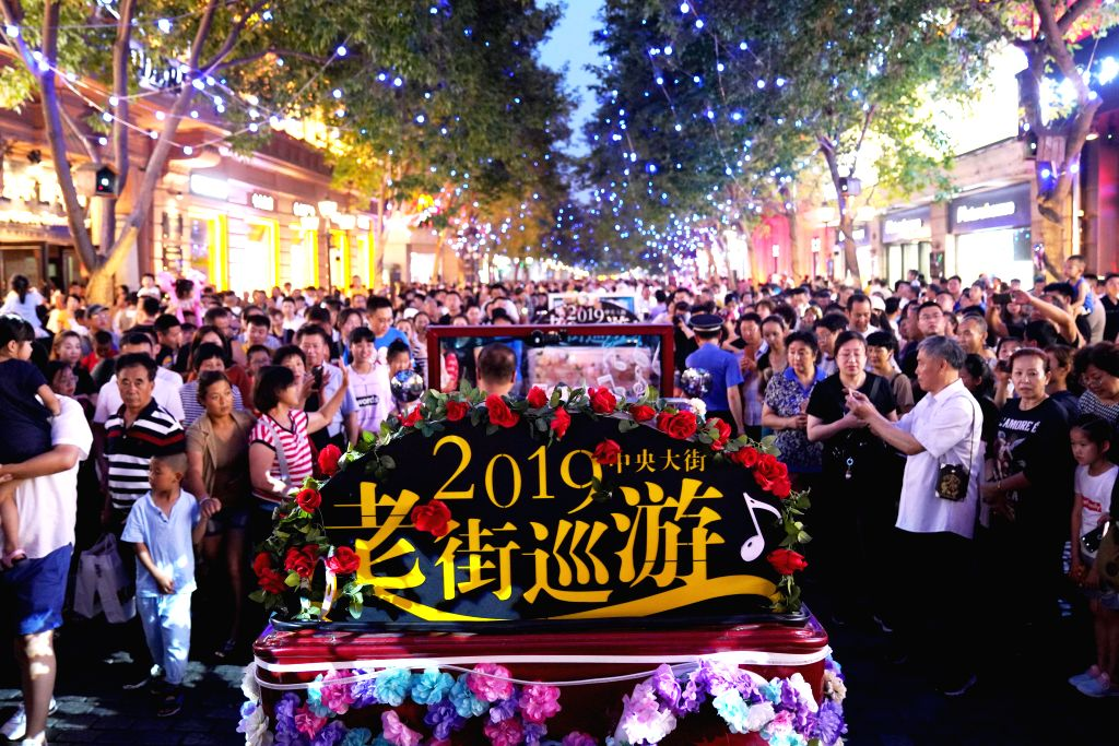 HARBIN, July 28, 2019 - A float parade is held on Zhongyang Street in Harbin, capital of northeast China's Heilongjiang Province, July 27, 2019. The city embraces its peak tourist season in the ...