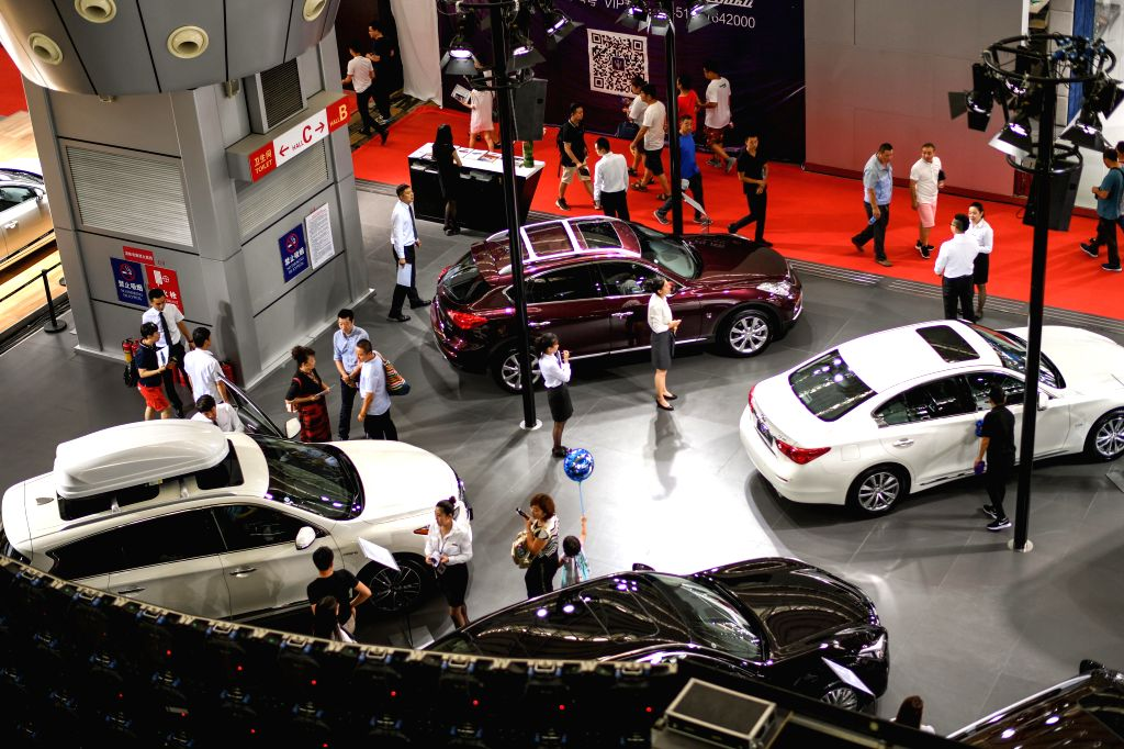 HARBIN, July 31, 2017 (Xinhua) -- Visitors look at cars during the 20th Harbin international automobile expo in Harbin, capital of northeast China's Heilongjiang Province, July 31, 2017. The expo kicked off on Monday will last for eight days and disp