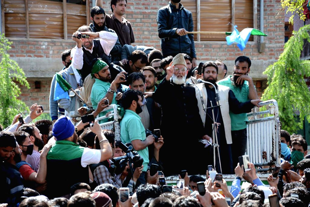Hardline Hurriyat leader Syed Ali Shah Geelani addresses a public rally in Tral of Jammu and Kashmir's Pulwama district on May 1, 2015.