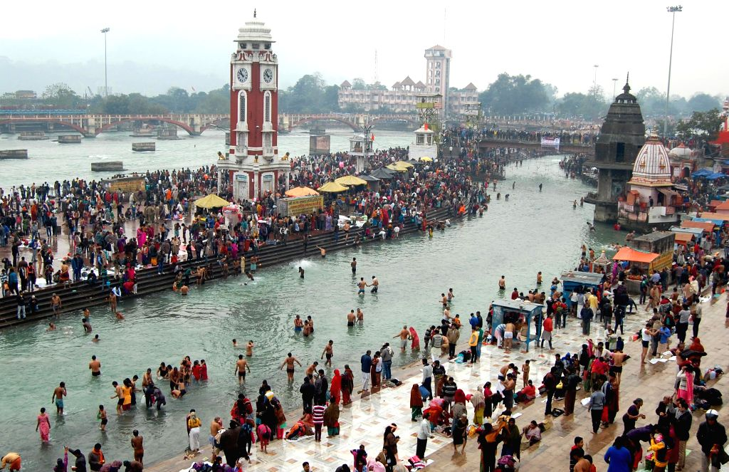 Devotees take holy dip in the Ganga river on Makar Sankranti in Haridwar on Jan 14, 2015.