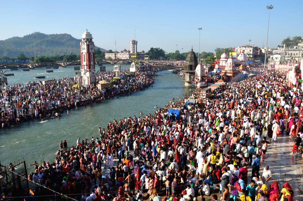 Devotees throng Har Ki Pauri in Haridwar, on May 4, 2015.