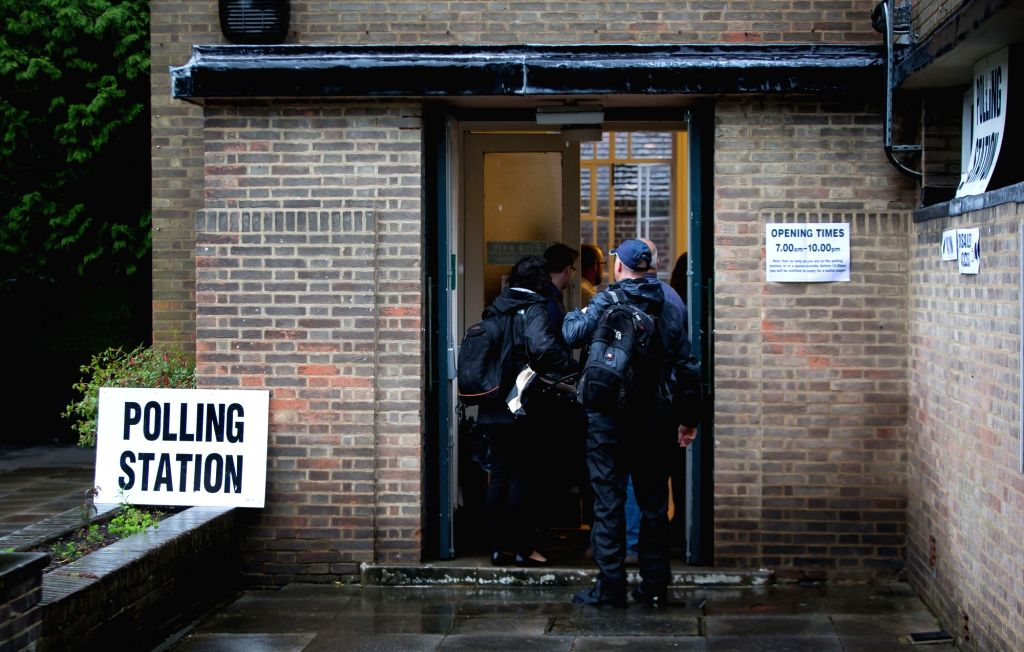 HARPENDEN, June 23, 2016 - People arrive at a polling station in Harpenden, Britain, on June 23, 2016. Millions of Britons will vote to stay in or leave the European Union (EU) on Thursday as polling ...