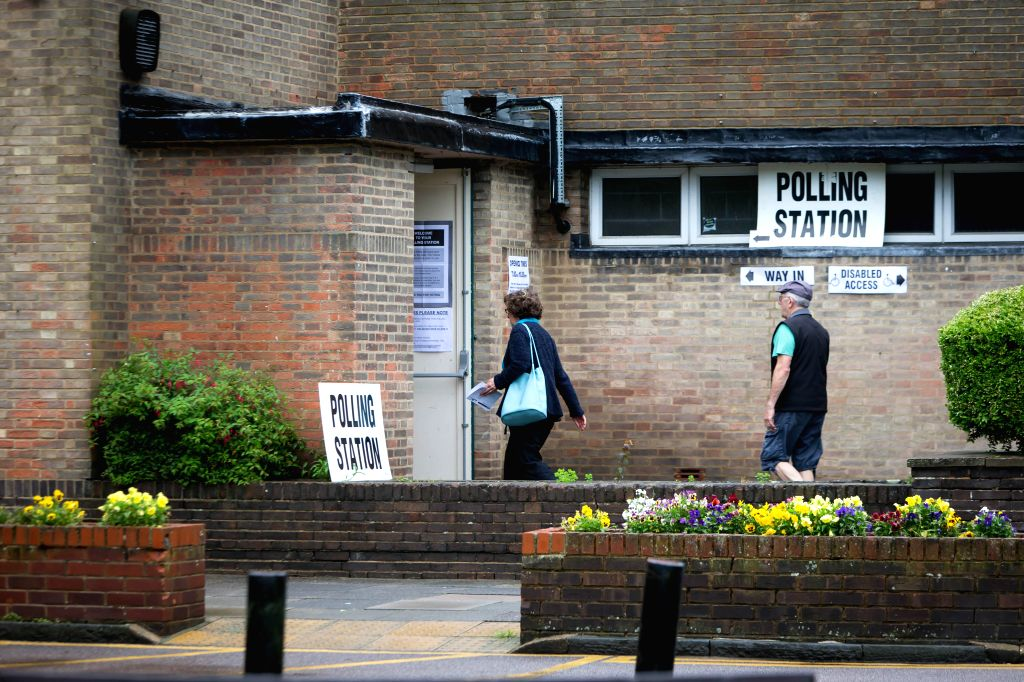 HARPENDEN, June 23, 2016 - People walk in a polling station in Harpenden, Britain, on June 23, 2016. Millions of Britons will vote to stay in or leave the European Union (EU) on Thursday as polling ...
