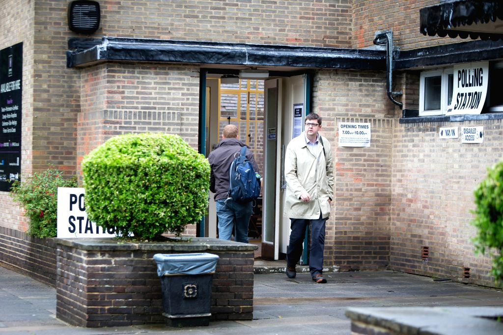HARPENDEN, June 23, 2016 - People walk in and out of a polling station in Harpenden, Britain, on June 23, 2016. Millions of Britons will vote to stay in or leave the European Union (EU) on Thursday ...